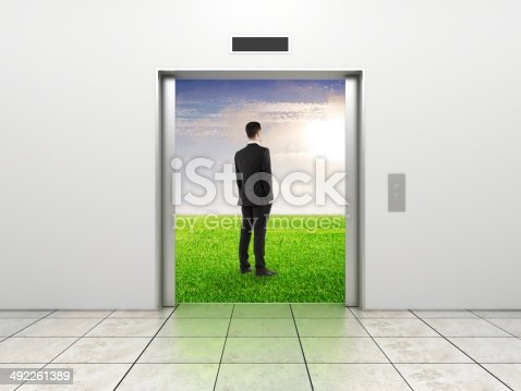 638591126 istock photo businessman and modern elevator 492261389