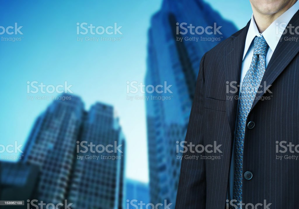 businessman and modern office building royalty-free stock photo