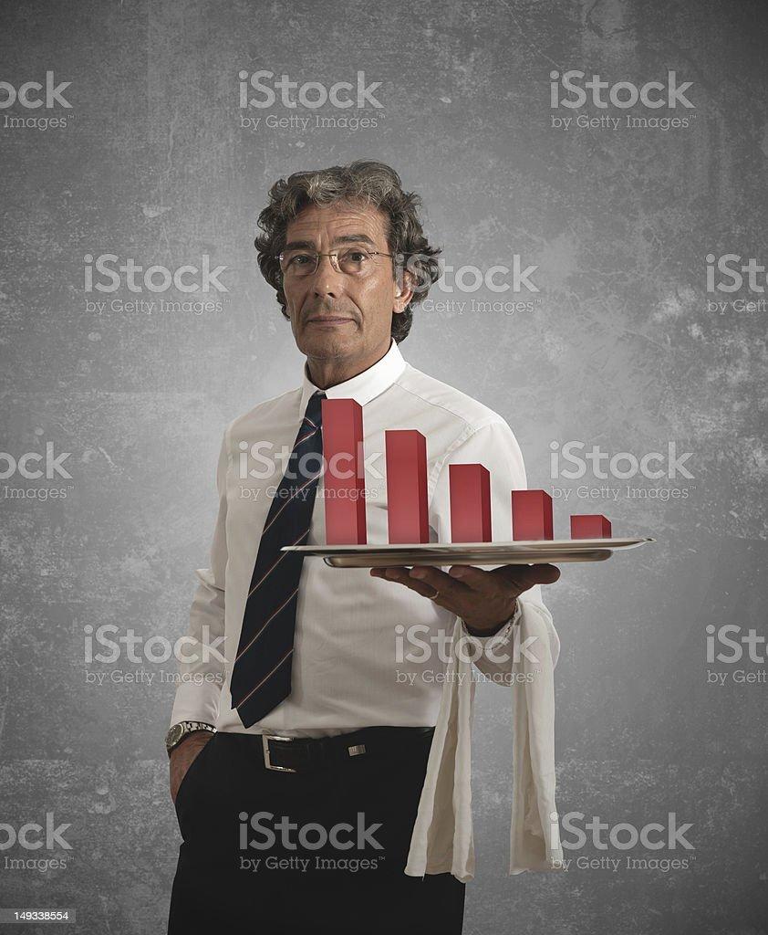 Businessman and negative statistics stock photo