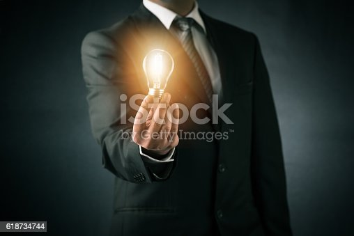 istock Businessman and new ideas concept 618734744