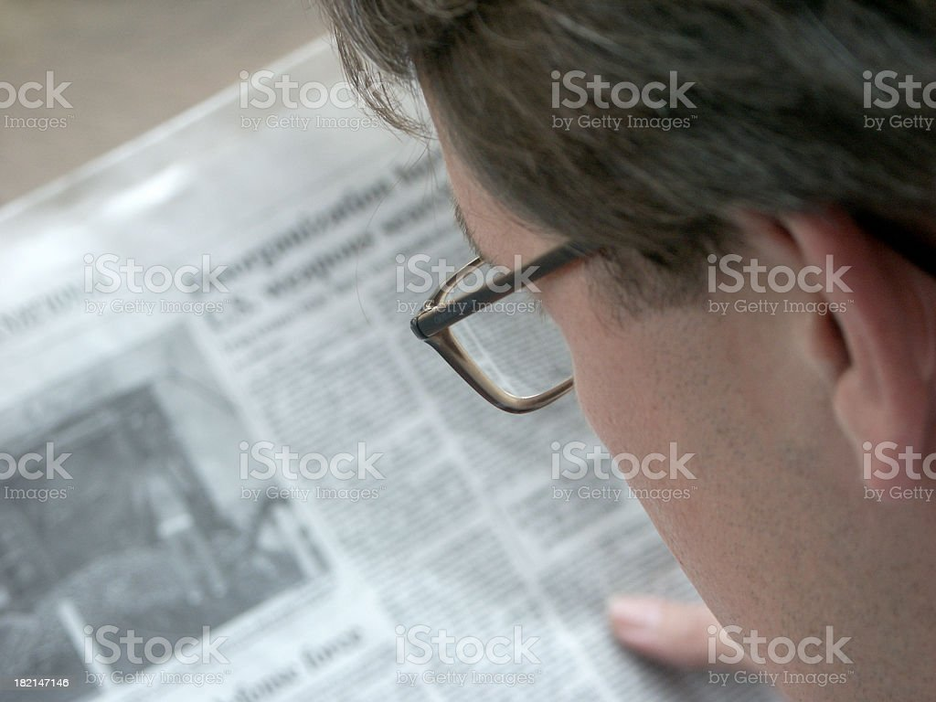 Businessman and Newspaper royalty-free stock photo