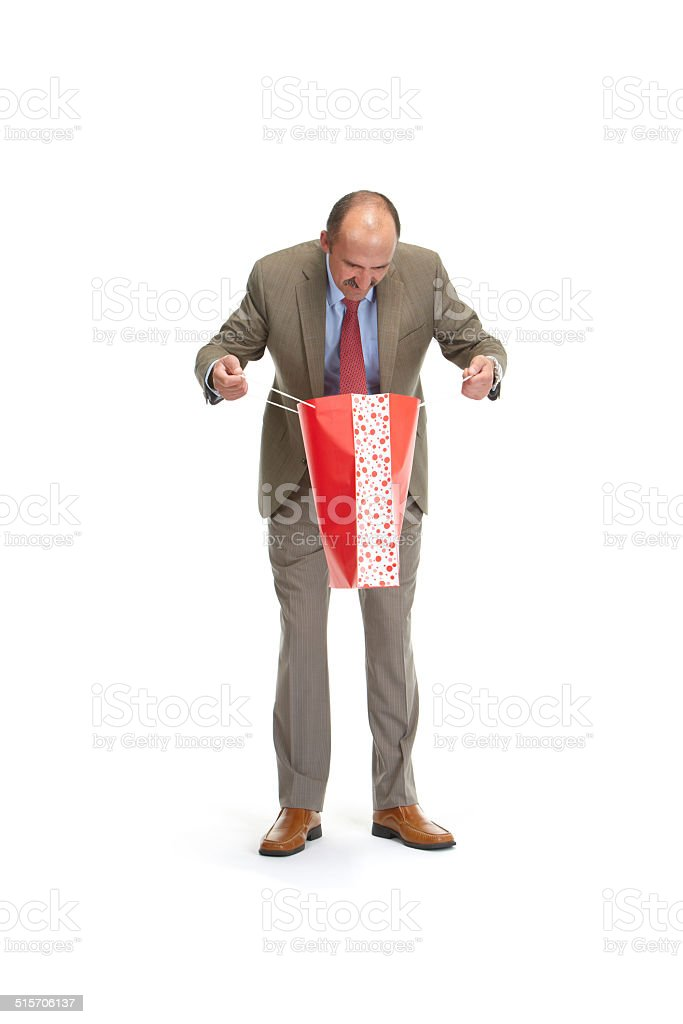 Businessman and paper bags stock photo