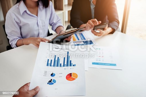 942382022istockphoto Businessman and partner are meeting to plan sales to meet targets set in next year. 950229090