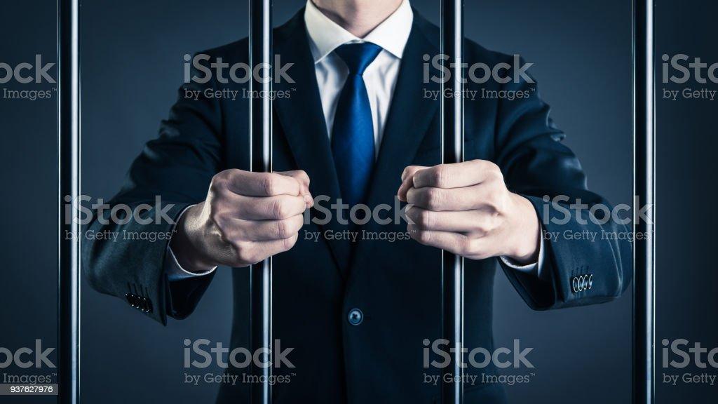 Businessman and prison stock photo