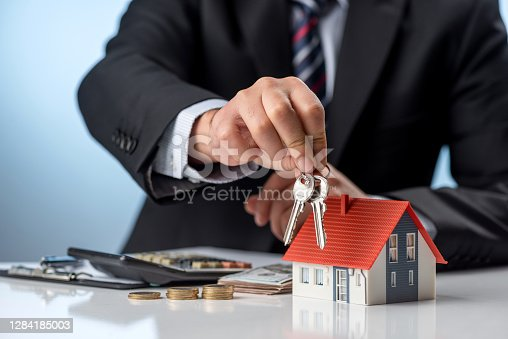 Businessman and purchase agreement for house. Home ownership concept.