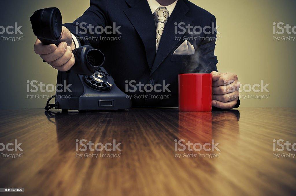 Businessman and retro phone stock photo