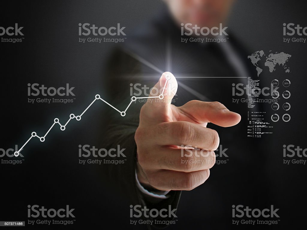 Businessman and Rising Financial Values stock photo