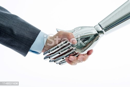 istock Businessman and robot shaking hands on white background 1148531636