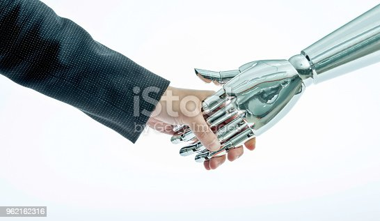 istock Businessman and robot shaking hands on white background 962162316