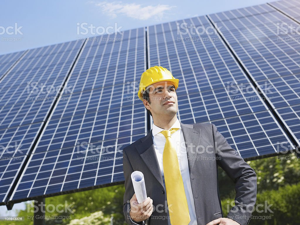businessman and solar panels royalty-free stock photo
