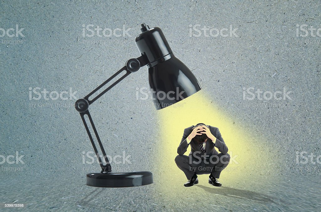 Businessman and spotlight stock photo