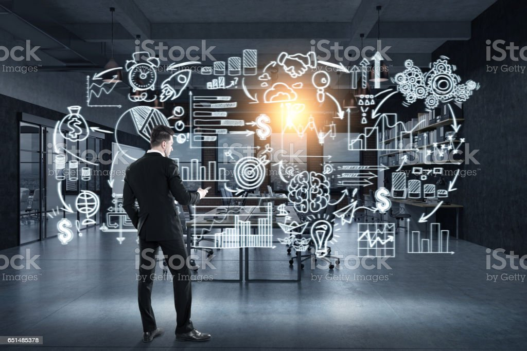 Businessman and start up icons on glassboard stock photo