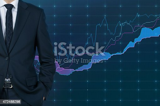 businessman standding and chart on virtual screen