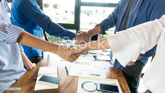 Businessman and team meeting on the table show hand working close up