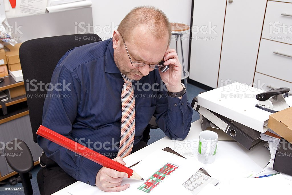 Businessman and the big red pencil royalty-free stock photo