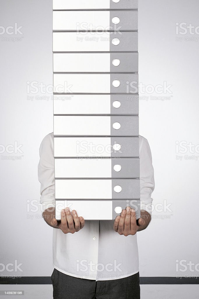 businessman and the binders royalty-free stock photo