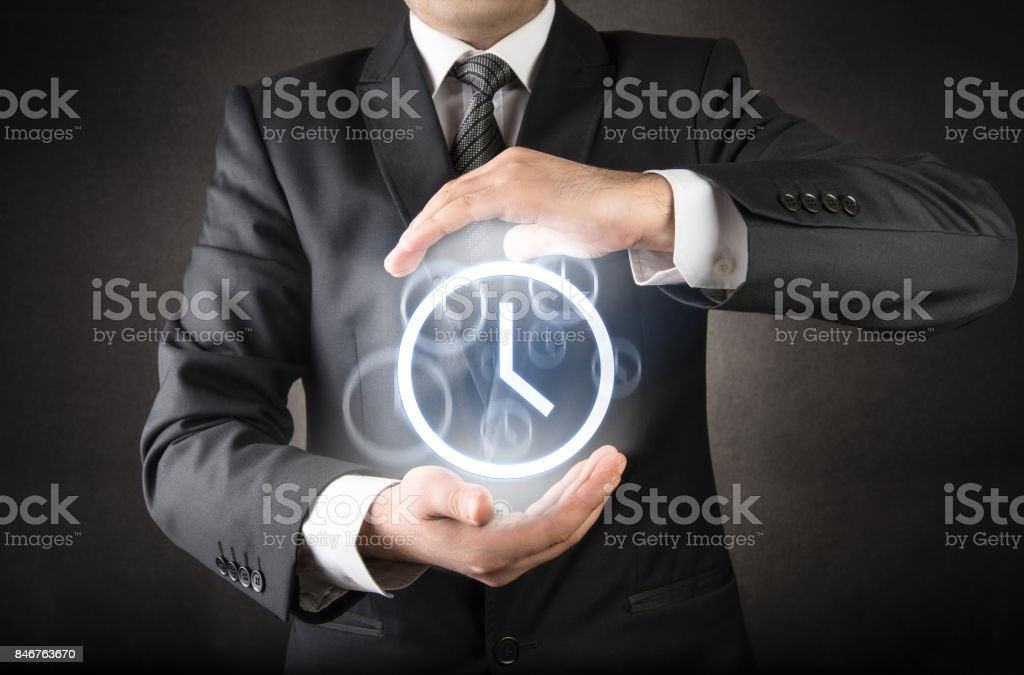 Businessman and Time to save concept stock photo