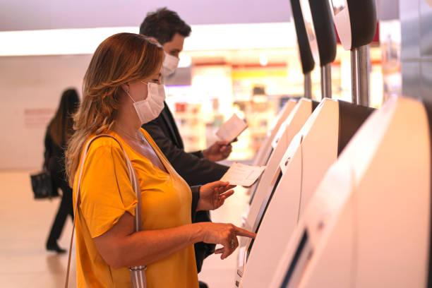 Businessman and woman at an airport checking in picture id1264287086?b=1&k=6&m=1264287086&s=612x612&w=0&h=wkpv3f0jzq kkjhxqgftq6yomw ax4u5vpfg4kawv58=
