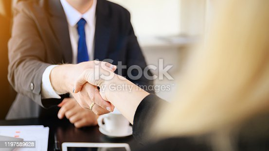 istock Businessman and woman shake hands as hello in office closeup. Friend welcome, introduction, greet or thanks gesture, product advertisement, partnership approval, arm, strike a bargain on deal concept 1197589628