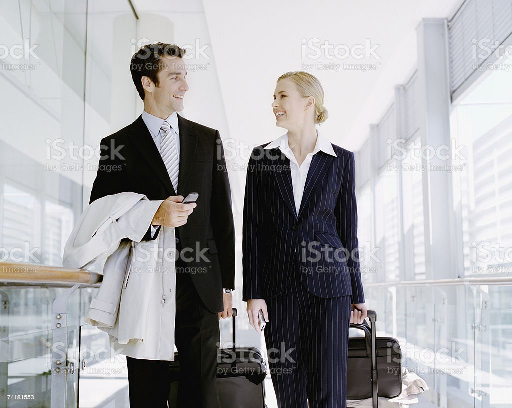 Businessman and woman traveling with cell phone royalty-free stock photo