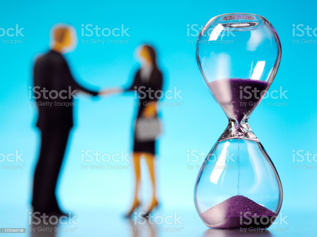 Businessman and Woman with a Hourglass royalty-free stock photo