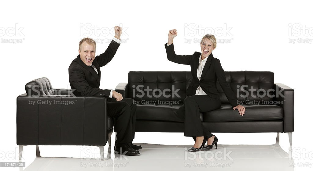 Businessman and woman with hands raised royalty-free stock photo