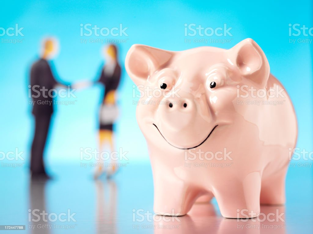 Businessman and Women with a Pink Pig Coin Bank royalty-free stock photo