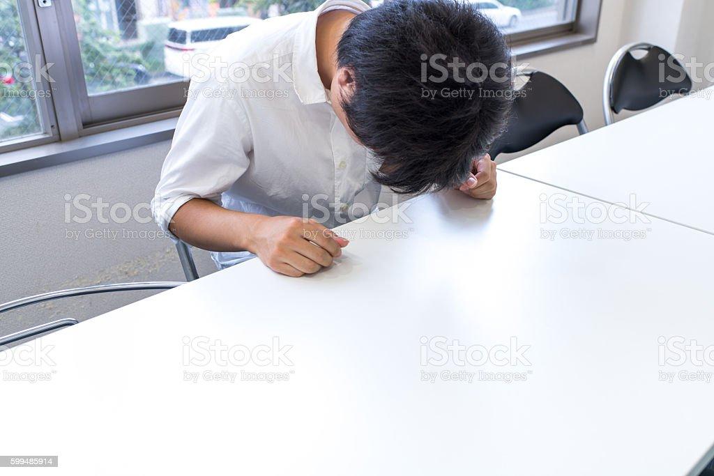 Businessman apologizing stock photo