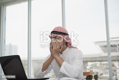 istock Businessman Arab men sitting stressed after working for long hours on laptop. Concept of emotional distress,  Business strain 933466968