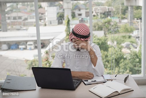 istock Businessman Arab men sitting stressed after working for long hours on laptop. Concept of emotional distress,  Business strain 935275010