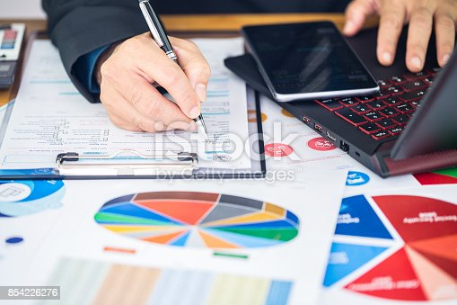 istock Businessman are filling personal income tax to file annual income tax returns to the government 854226276