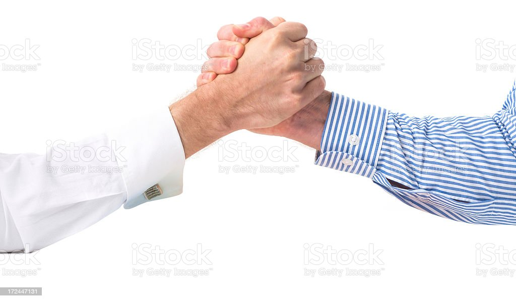 businessman arm wrestling holding hands royalty-free stock photo