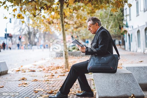 istock Businessman arranging meetings on tablet during his lunch-break 896749738