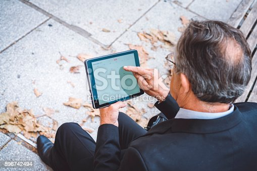 istock Businessman arranging meetings on tablet 896742494