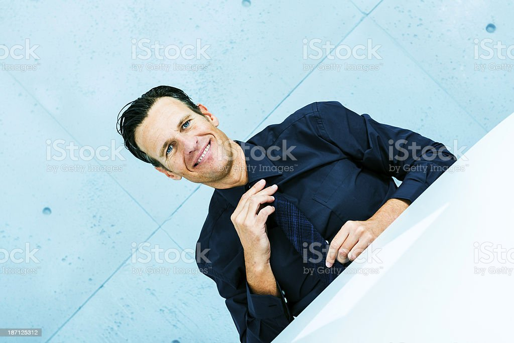 Businessman arranging tie royalty-free stock photo