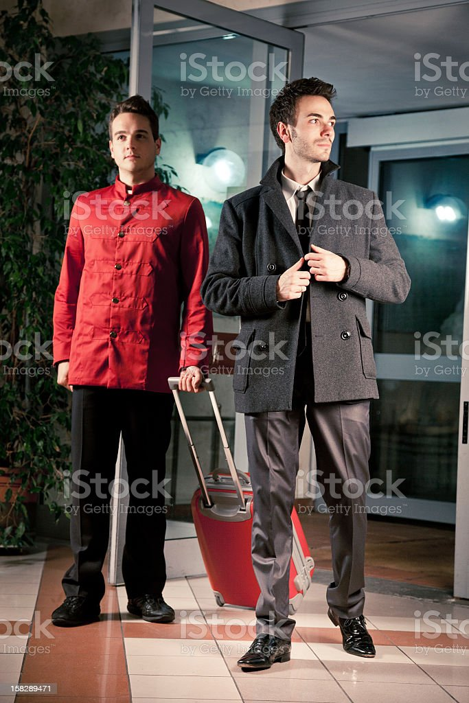 Businessman arriving in hotel lobby royalty-free stock photo