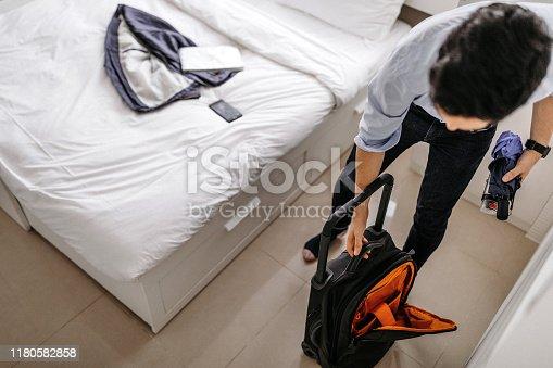 istock Businessman arriving in hotel room 1180582858