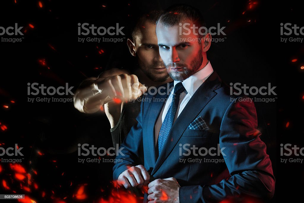 Businessman as an athlete fighter, alter ego aggressive businessman stock photo