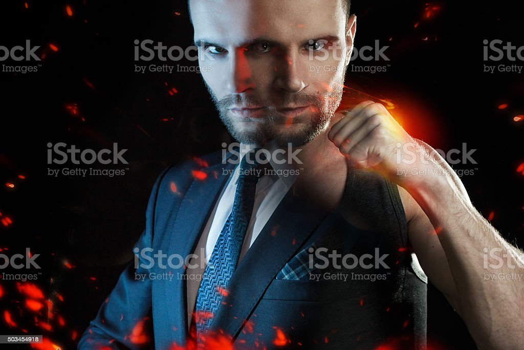 Businessman as an athlete fighter, alter ego strong businessman stock photo