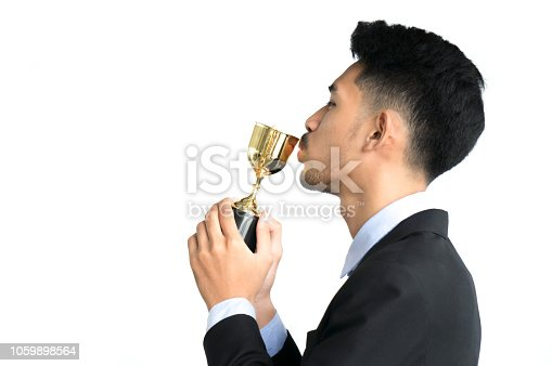 544347868 istock photo Businessman as winner kiss trophy award isolated on white background 1059898564