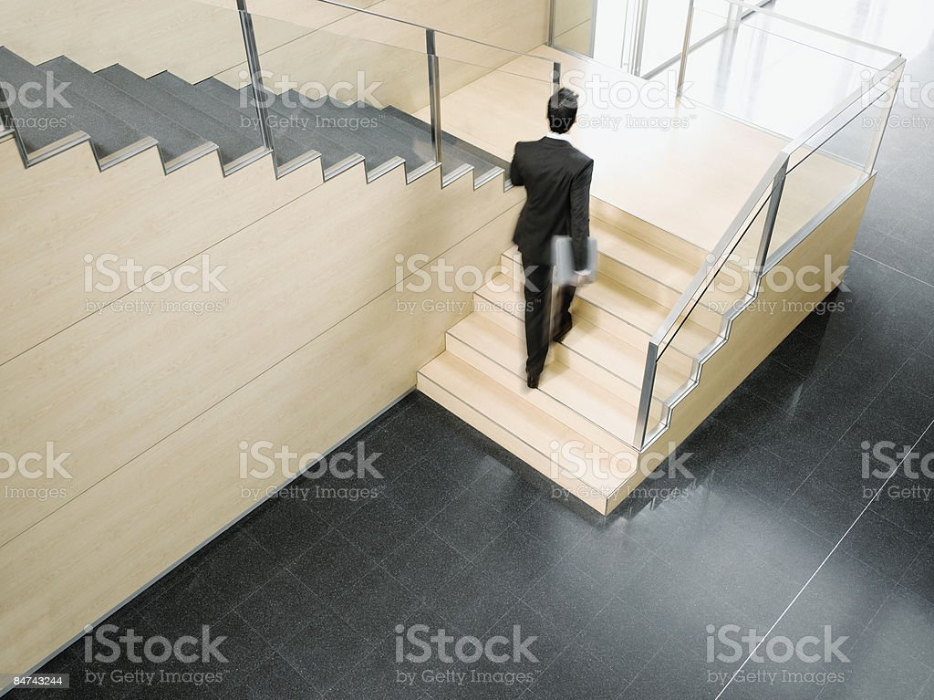 Businessman ascending office stairs royalty-free stock photo