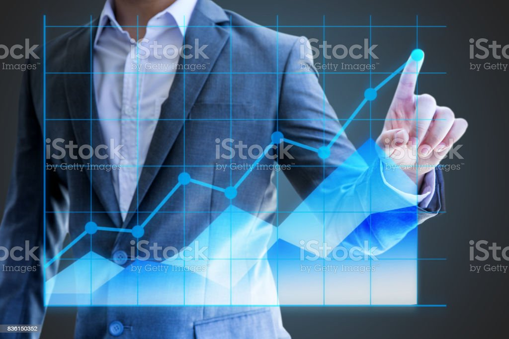 businessman asian use hand show line graph holographic statistics  sales economics company in quarter this year success to investor for reliability stock photo