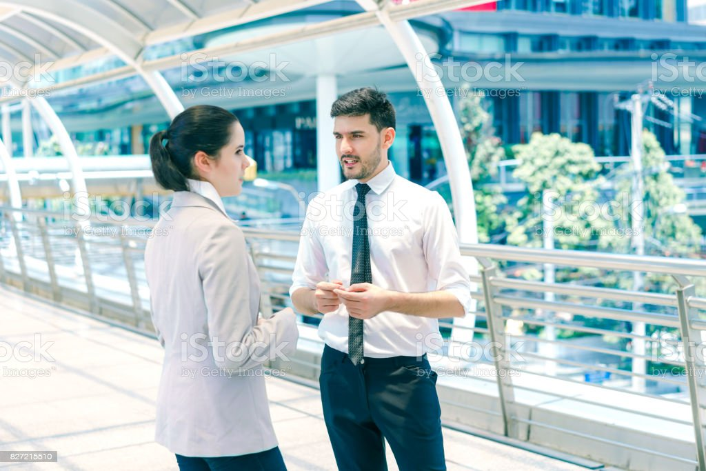Businessman ask for advice from woman colleagues, young male and female entrepreneurs working together, concept of business negotiation and deal benefit. stock photo