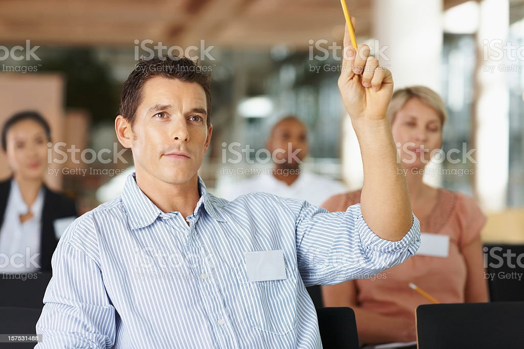 Businessman asking a question in meeting royalty-free stock photo