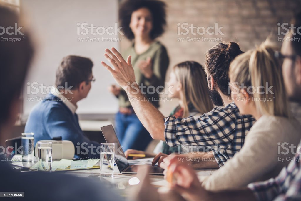 Businessman asking a question on a meeting in the office. stock photo