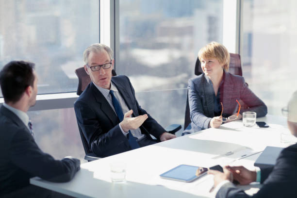 Businessman asking for ideas in conference room meeting stock photo