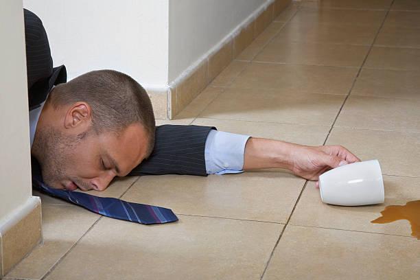businessman asleep on the floor - coffe with death bildbanksfoton och bilder