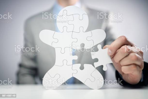 Businessman assembling jigsaw puzzle human team employee picture id881488148?b=1&k=6&m=881488148&s=612x612&h=wg21 4gz8i2anxscnmszy36ylutqu8orxa xxvhm5w0=