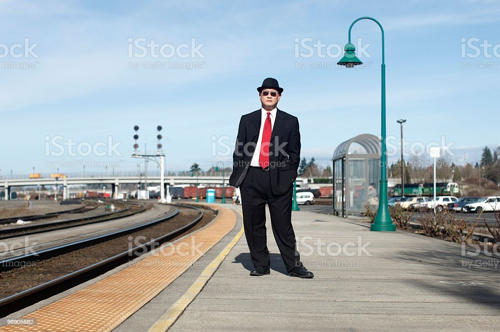 Businessman at a train station. royalty-free stock photo