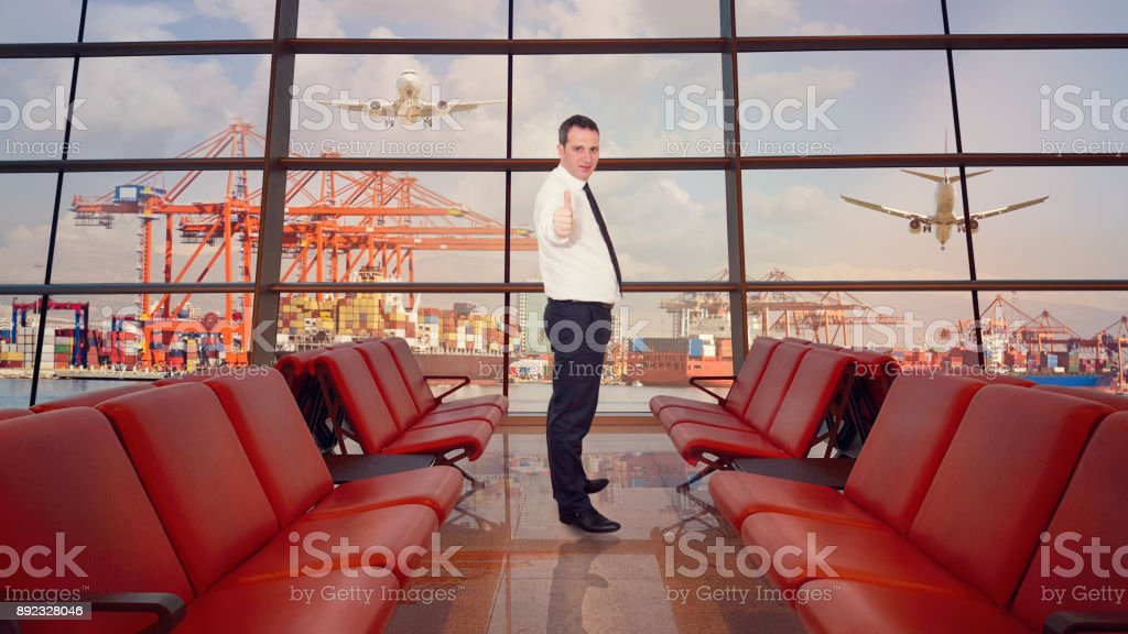 Businessman at airport - double exposure stock photo